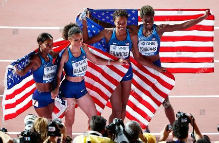 US relay team members (L-R) Dalilah Muhammad, Sydney McLaughlin, Phyllis Francis, and Wadeline Jonathas celebrate after winning the women's 4x400m Relay final at the IAAF World Athletics Championships 2019 at the Khalifa Stadium in Doha, Qatar, 06 October 2019.