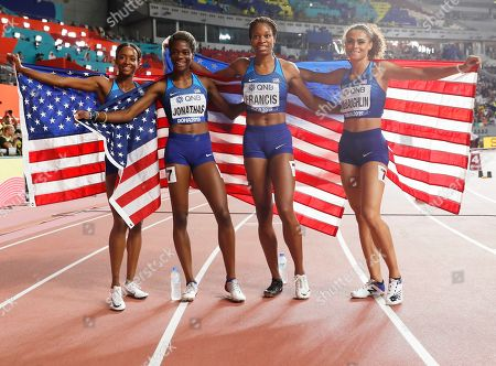 The US relay team (L-R) Dalilah Muhammad, Wadeline Jonathas, Phyllis Francis and Sydney McLaughlin celebrate after winning the women's 4x400m Relay final at the IAAF World Athletics Championships 2019 at the Khalifa Stadium in Doha, Qatar, 06 October 2019.