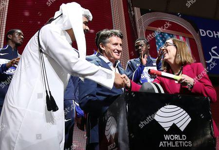 Stock Image of The governnor of Oregon Kate Brown (R) takes the simbolic batton from Qatari Sheikh Joaan bin Hamad bin Khalifa Al-Thani (L) and IAAF president Sebastian Coe during the closing ceremony of the IAAF World Athletics Championships 2019 at the Khalifa Stadium in Doha, Qatar, 06 October 2019. Eugene, Oregon, will host the World Championships in 2021.