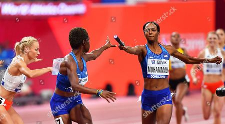 Dalilah Muhammad (R) of the USA hands over to her teammate Wadeline Jonathas (C) on their way to win the women's 4x400m Relay final at the IAAF World Athletics Championships 2019 at the Khalifa Stadium in Doha, Qatar, 06 October 2019.