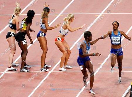 Dalilah Muhammad (R) of the USA hands over to her teammate Wadeline Jonathas (2-R) on their way to win the women's 4x400m Relay final at the IAAF World Athletics Championships 2019 at the Khalifa Stadium in Doha, Qatar, 06 October 2019.
