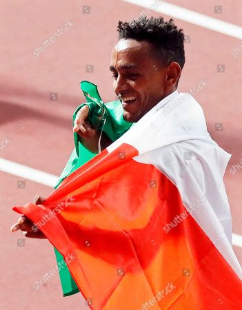 Stock Image of Yemaneberhan Crippa of Italy reacts after competing in the men's 10,000m final at the IAAF World Athletics Championships 2019 at the Khalifa Stadium in Doha, Qatar, 06 October 2019.