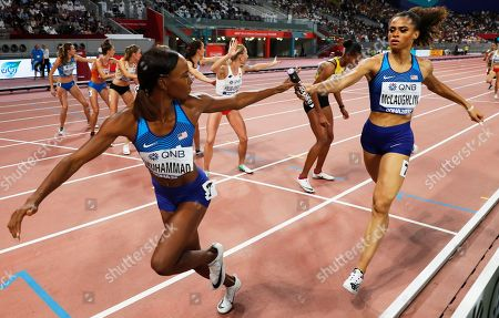 Sydney McLaughlin (R) of the USA hands over the baton to Dalilah Muhammad during the women's 4x400m Relay final at the IAAF World Athletics Championships 2019 at the Khalifa Stadium in Doha, Qatar, 06 October 2019.