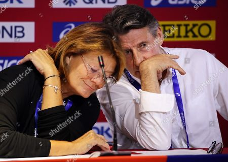 IAAF president Sebastian Coe (R) of Britain and IAAF Communications Director Jackie Brock-Doyle (L) attend a press conference at the IAAF World Athletics Championships 2019 at the Khalifa Stadium in Doha, Qatar, 06 October 2019.