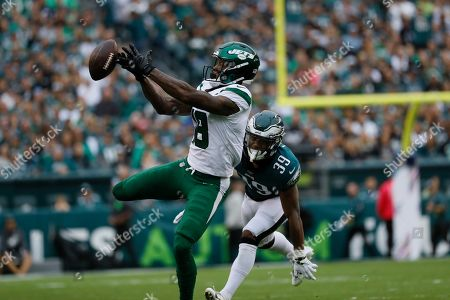 New York Jets' Demaryius Thomas, left, cannot catch a pass against Philadelphia Eagles' Craig James during the second half of an NFL football game, in Philadelphia