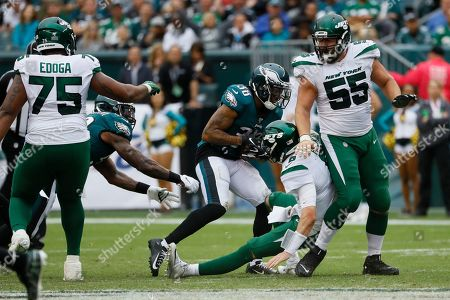 Philadelphia Eagles' Orlando Scandrick (38) strips the ball from New York Jets' Luke Falk (8) for an eventual touchdown during the second half of an NFL football game, in Philadelphia