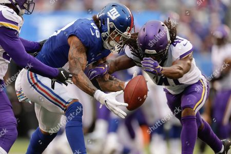 New York Giants tight end Evan Engram (88) can't make the catch Minnesota Vikings defensive back Anthony Harris (41) breaks up the pass during the fourth quarter of an NFL football game, in East Rutherford, N.J