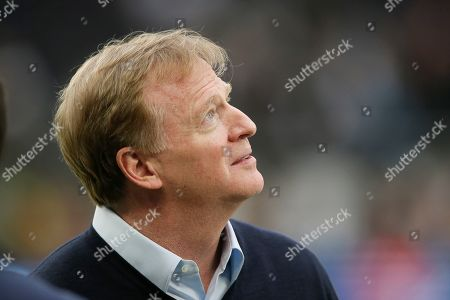 NFL Commissioner Roger Goodell looks at Wembley Stadium before an NFL football game between the Chicago Bears and the Oakland Raiders, in London