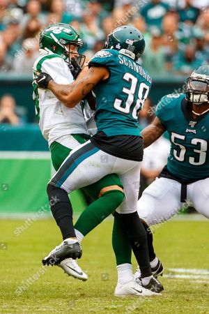 Philadelphia Eagles defensive back Orlando Scandrick (38) runs into New York Jets quarterback Luke Falk (8), and steals the ball for a touchdown during the NFL game between the New York Jets and the Philadelphia Eagles at Lincoln Financial Field in Philadelphia, Pennsylvania