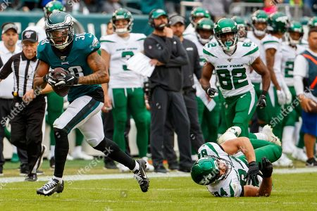 Philadelphia Eagles defensive back Orlando Scandrick (38) returns the turnover for a touchdown as he gets past New York Jets tight end Ryan Griffin (84) during the NFL game between the New York Jets and the Philadelphia Eagles at Lincoln Financial Field in Philadelphia, Pennsylvania