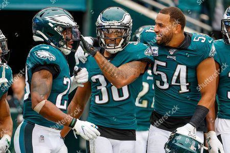 Philadelphia Eagles defensive back Orlando Scandrick (38) celebrates with free safety Rodney McLeod (23) and outside linebacker Kamu Grugier-Hill (54) during the NFL game between the New York Jets and the Philadelphia Eagles at Lincoln Financial Field in Philadelphia, Pennsylvania