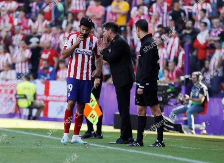 Stock Image of Atletico Madrid's head coach Diego Pablo Simeone (C) talks to player Diego Costa (L) during the Spanish LaLiga soccer match between Real Valladolid and Atletico Madrid at the Jose Zorrilla stadium in Valladolid, Spain, 06 October 2019