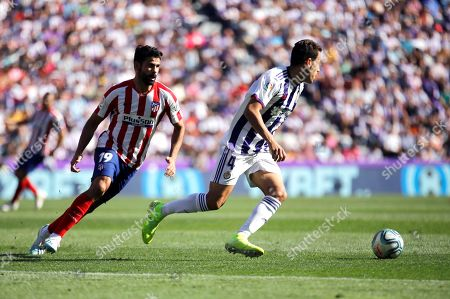Atletico Madrid's Diego Costa (L) in action against Real Valladolid's Kiko Olivas during the Spanish LaLiga soccer match between Real Valladolid and Atletico Madrid at the Jose Zorrilla stadium in Valladolid, Spain, 06 October 2019