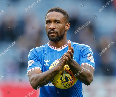 Jermain Defoe of Rangers applauds the Ibrox crowd while holding the match ball after scoring a hat-trick in Rangers 5-0 win over Hamilton Academical.
