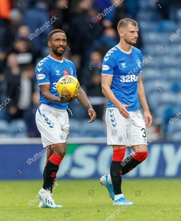Jermain Defoe of Rangers applauds the Ibrox crowd while holding the match ball after scoring a hat-trick in Rangers 5-0 win over Hamilton Academical, with fellow goalscorer Borna Barisic, right.