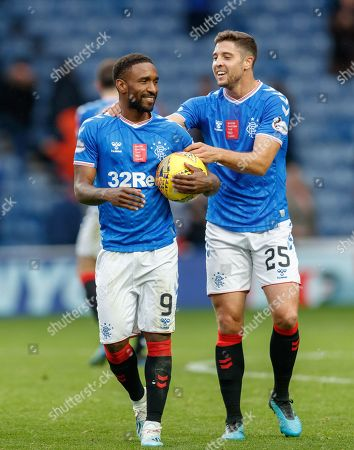 Jermain Defoe of Rangers clutches the match ball, with team mate Matthew Polster, right, after scoring a hat-trick in Rangers 5-0 win over Hamilton Academical.