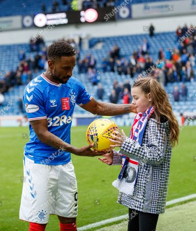 Stock Photo of Jermain Defoe of Rangers poses with Amber Smith from Glasgow and the match ball after scoring a hat-trick in Rangers 5-0 win over Hamilton Academical.