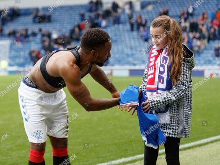 Jermain Defoe of Rangers gives his jersey to young Rangers fan Amber Smith from Glasgow after scoring a hat-trick in Rangers 5-0 win over Hamilton Academical.