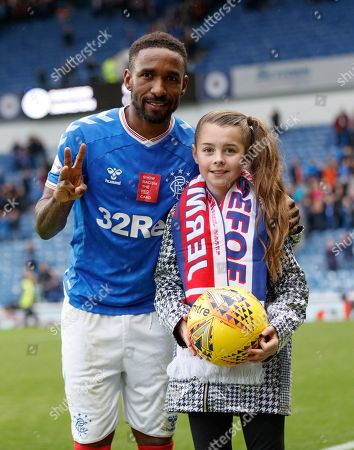 Jermain Defoe of Rangers poses with Amber Smith from Glasgow and the match ball after scoring a hat-trick in Rangers 5-0 win over Hamilton Academical.