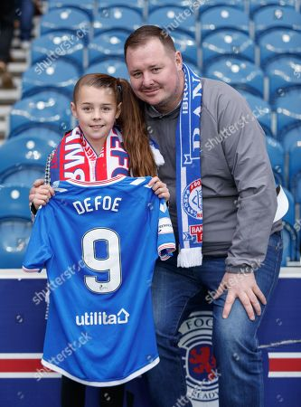 Amber Smith & her Dad Derek Smith (from Glasgow) pose with Jermain Defoe of Rangers' jersey after the final whistle. Defoe gave Amber his jersey & posed for photos with the match ball after scoring a hat-trick in Rangers 5-0 win over Hamilton Academical.