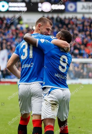 Borna Barisic of Rangers celebrates with team mate Jermain Defoe after Defoe scored his hat-trick goal to give Rangers a 5-0 lead.