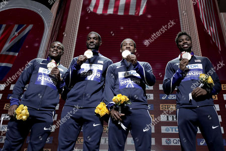Gold medalists from left, Christian Coleman, Justin Gatlin, Michael Rodgers and Noah Lyles of the United States pose during the medal ceremony for the men's 4x100 meter relay at the World Athletics Championships in Doha, Qatar
