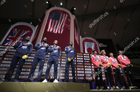 Stock Photo of Gold medalists from left, Christian Coleman, Justin Gatlin, Michael Rodgers and Noah Lyles of the United States stand next to Japan, bronze, during the medal ceremony for the men's 4x100 meter relay at the World Athletics Championships in Doha, Qatar