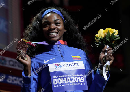 Bronze medalist Caterine Ibarguen of Colombia, poses during the medal ceremony for the women's triple jump at the World Athletics Championships in Doha, Qatar