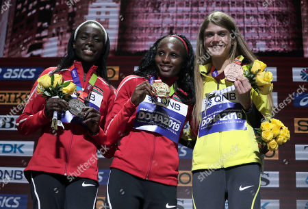 Medalists Hellen Obiri of Kenya, gold, Margaret Chelimo Kipkemboi of Kenya, silver, and Konstanze Klosterhalfen of Germany, bronze, pose during the medal ceremony for the women's 5000m at the World Athletics Championships in Doha, Qatar
