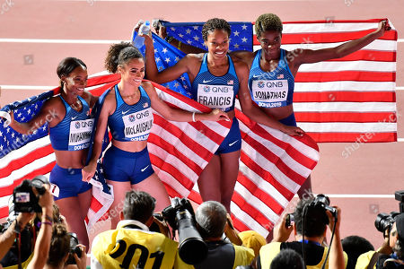 Gold medalists Dalilah Muhammad, Sydney Mclaughlin, Phyllis Francis and Wadeline Jonathas, from left, celebrate winning the women's 4x400 meter relay final at the World Athletics Championships in Doha, Qatar