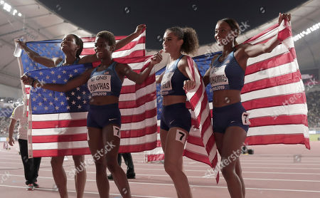 U.S. gold medalists Dalilah Muhammad, Sydney Mclaughlin, Phyllis Francis and Wadeline Jonathas, from left, celebrate winning the women's 4x400 meter relay final at the World Athletics Championships in Doha, Qatar