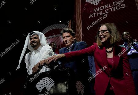 Sheikh Joaan bin Hamad bin Khalifa Al Thani, IAAF President Sebastian Coe and Oregon Governor Kate Brown pose at the closing ceremony for the World Athletics Championships in Doha, Qatar
