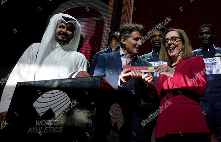 Sheikh Joaan bin Hamad bin Khalifa Al Thani, IAAF President Sebastian Coe hands over a ceremonial baton to Oregon Governor Kate Brown pose at the closing ceremony for the World Athletics Championships in Doha, Qatar