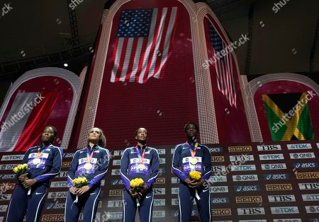U.S. gold medalists from left, Phyllis Francis, Sydney Mclaughlin, Dalilah Muhammad and Wadeline Jonathas, stand on the podium during the medal ceremony for women's 4x400 meter relay final at the World Athletics Championships in Doha, Qatar