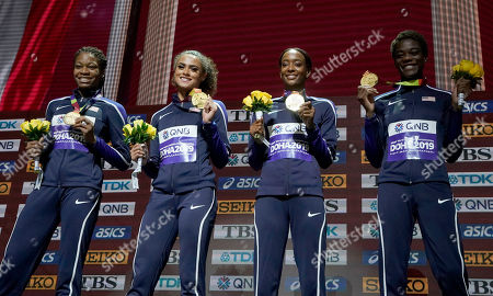 U.S. gold medalists from left, Phyllis Francis, Sydney Mclaughlin, Dalilah Muhammad and Wadeline Jonathas, stand on the podium during the medal ceremony for the women's 4x400 meter relay final at the World Athletics Championships in Doha, Qatar