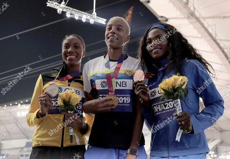Medalists Yulimar Rojas of Venezuela, gold, Shanieka Ricketts of Jamaica, silver, and Caterine Ibarguen of Colombia, bronze, pose during the medal ceremony for the women's triple jump at the World Athletics Championships in Doha, Qatar