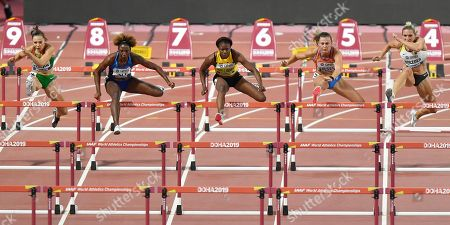 Luca Kozak, of Hungary, Nia Ali, of the United States, left, Danielle Williams, of Jamaica, Nadine Visser, of the Netherlands, and Cindy Roleder, of Germany, from left, compete in the women's 100 meter hurdles semifinal at the World Athletics Championships in Doha, Qatar