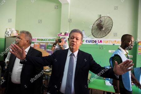 Leonel Fernandez, presidential candidate by the Dominican Liberation Party, speaks reporters as he goes to vote in the primary elections in Santo Domingo, the Dominican Republic, 06 October 2019.
