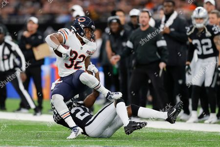 Chicago Bears running back David Montgomery (32) is tackled by Oakland Raiders cornerback Gareon Conley (21) during the first half of an NFL football game at Tottenham Hotspur Stadium, in London