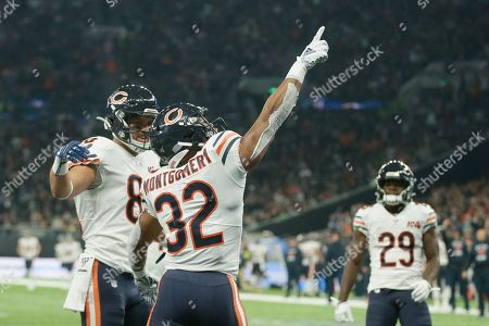 Chicago Bears running back David Montgomery (32) celebrates a touchdown during the second half of an NFL football game against the Oakland Raiders at Tottenham Hotspur Stadium, in London