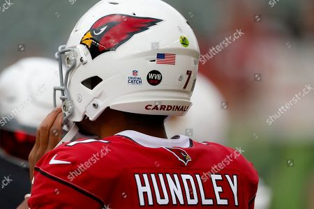 Arizona Cardinals quarterback Brett Hundley (7) practices with a sticker on his helmet commemorating the late Cardinal's owner Bill Bidwill before an NFL football game against the Cincinnati Bengals, in Cincinnati
