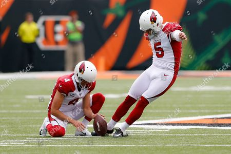 Stock Image of Zane Gonzalez, Andy Lee. Arizona Cardinals kicker Zane Gonzalez (5) practices alongside punter Andy Lee (4) before an NFL football game against the Cincinnati Bengals, in Cincinnati