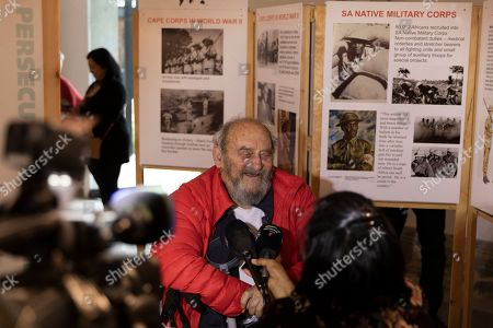Former Rivonia Trialist and long-term political prisoner Denis Goldberg (C) who was imprisoned during apartheid with Nelson Mandela is interviewed by media during opening of the Forgotten Liberators exhibition at the Desmond & Leah Tutu Legacy Foundation in Cape Town, South Africa 06 October 2019. The exhibition, sub-titled, Third World in World War II, presents a decolonised history of the Second World War, acknowledging the six million Jews who died in the holocaust as well as the 20 million others including gay and lesbian people, gypsies, communists and third world conscripts  who lost their lives opposing the racism of Nazi Germany. The exhibition is the product of more than 20 years of research conducted by a group of scientists and journalists based in Cologne, Germany.  Approximately one million people from Great Britain?s colonies and another million people from French Colonies were conscripted as soldiers. They fought in the winters of Europe without adequate clothing or equipment, the colonies having to provide 90% of the materials for the war, including food. Not only did many die in battle, but they died of starvation while their families at home lost essential harvests.