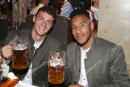 Stock Photo of Jerome Boateng (re) and Benjamin Pavard   Besuch team des FC Bayern Muenchen auf dem Oktoberfest6.10.2019 in Muenchen.
