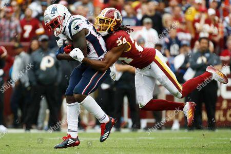 Washington Redskins cornerback Josh Norman (24) tacklesNew England Patriots running back Sony Michel (26) during the second half of an NFL football game, in Washington