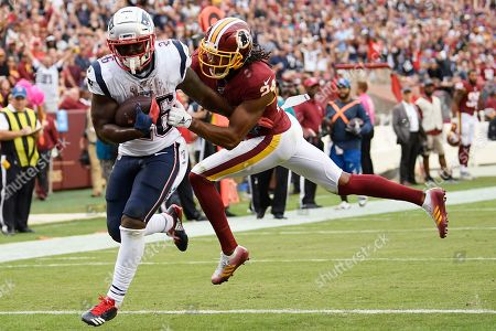New England Patriots running back Sony Michel (26) scores a touchdown against Washington Redskins cornerback Josh Norman (24) during the second half of an NFL football game, in Washington