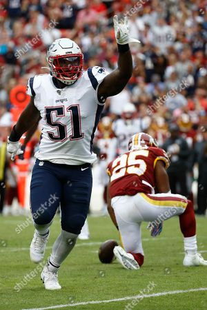 New England Patriots linebacker Ja'Whaun Bentley (51) celebrates a tackle against Washington Redskins running back Chris Thompson (25) during the second half of an NFL football game, in Washington