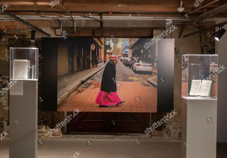 An image by South African photographer Sumaya Hisham of Archbishop Emeritus Desmond Tutu crossing a road on exhibit with writings by the Nobel Peace laureate Desmond Tutu at the Desmond and Leah Tutu Legacy Foundation in Cape Town, South Africa 06 October 2019. Nobel Peace laureate Archbishop Emeritus Desmond Tutu turns 88 on 07 October 2019.