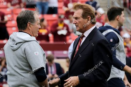 Stock Photo of New England Patriots head coach Bill Belichick, left, speaks with former NFL player Joe Theismann ahead of an NFL football game between the Washington Redskins and the New England Patriots, in Washington