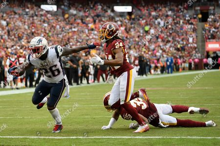 Stock Photo of New England Patriots running back Sony Michel (26) scores a touchdown against Washington Redskins cornerback Josh Norman (24) during the second half of an NFL football game, in Washington